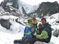 Family playing in snow at Rohtang Pass, Himachal Pradesh